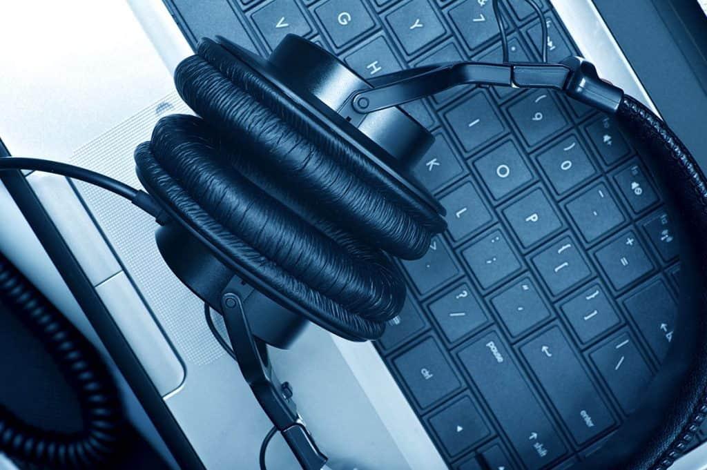 Headphones sitting on a laptop keyboard.