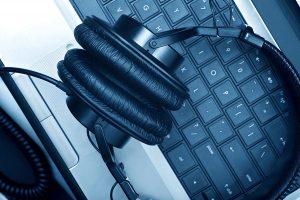 Headphones sitting on a laptop keyboard.