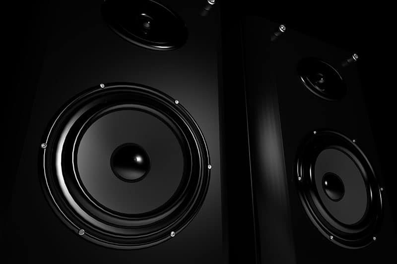 Close up photo of two studio monitors.