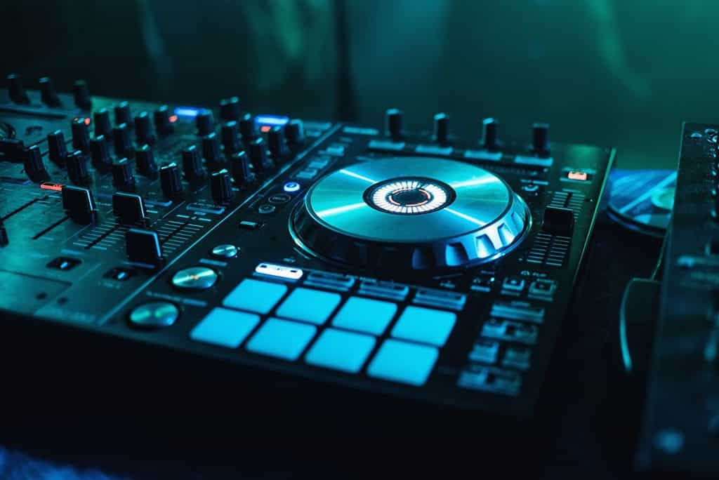 Picture of a DJ controller focusing on the cue buttons.