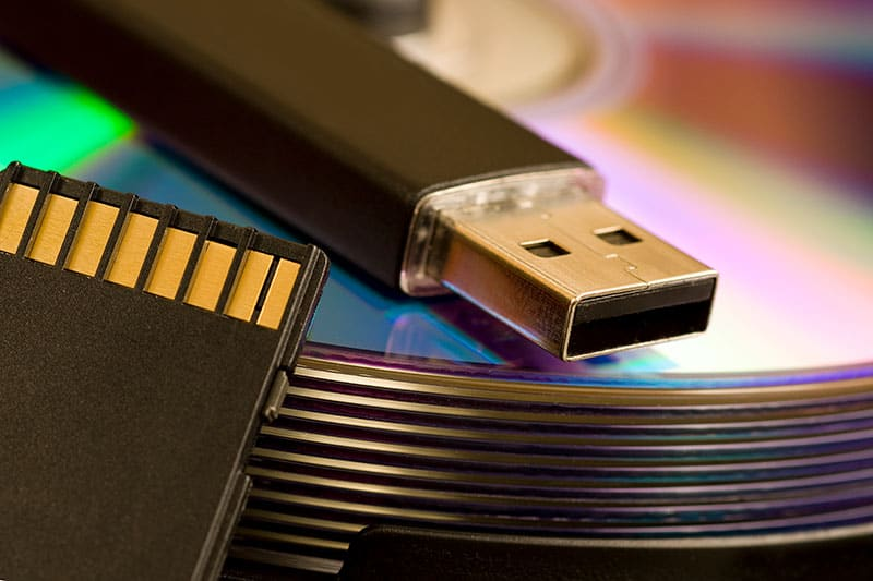 Photo of CDs, USB and SD card.