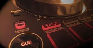 Clos up photo of the Sync button on a DJ controller.