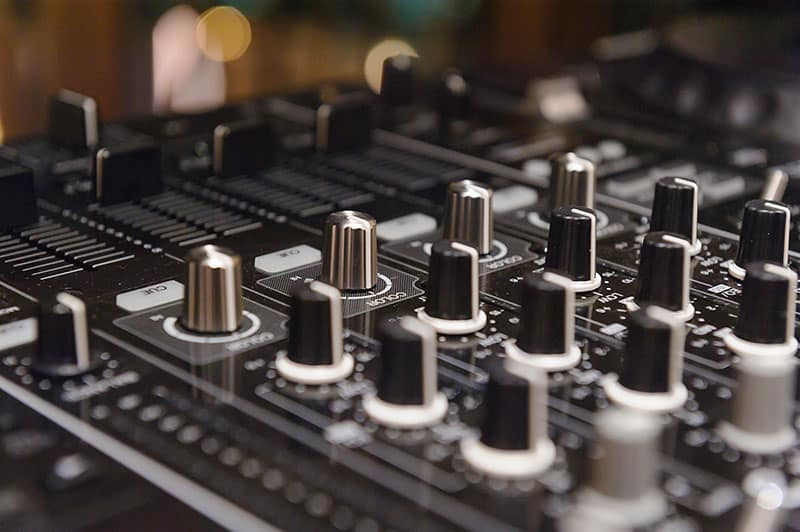 Close-up photo of a 4-channel DJ controller.
