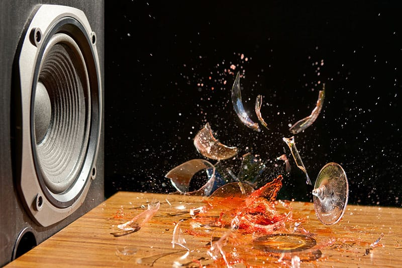 Photo of a speaker breaking a glass.