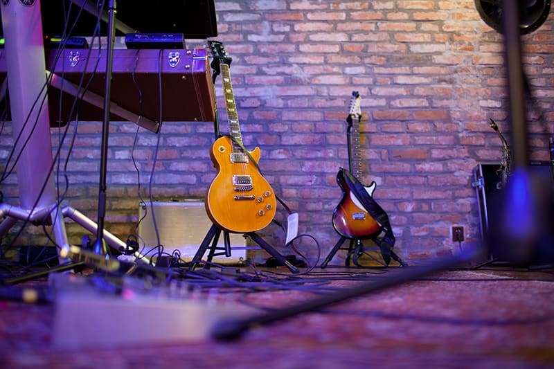 Photo of a music stage with guitars and other equipment.