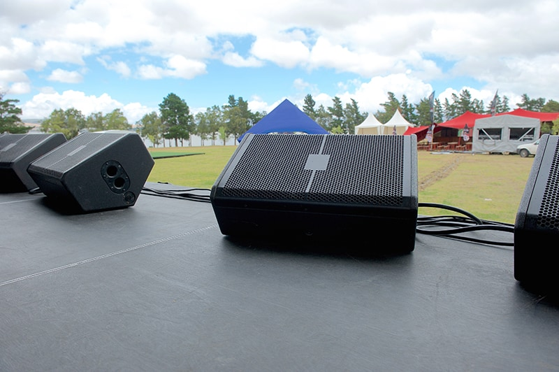 Speakers set up on a stage in a stage monitor position.