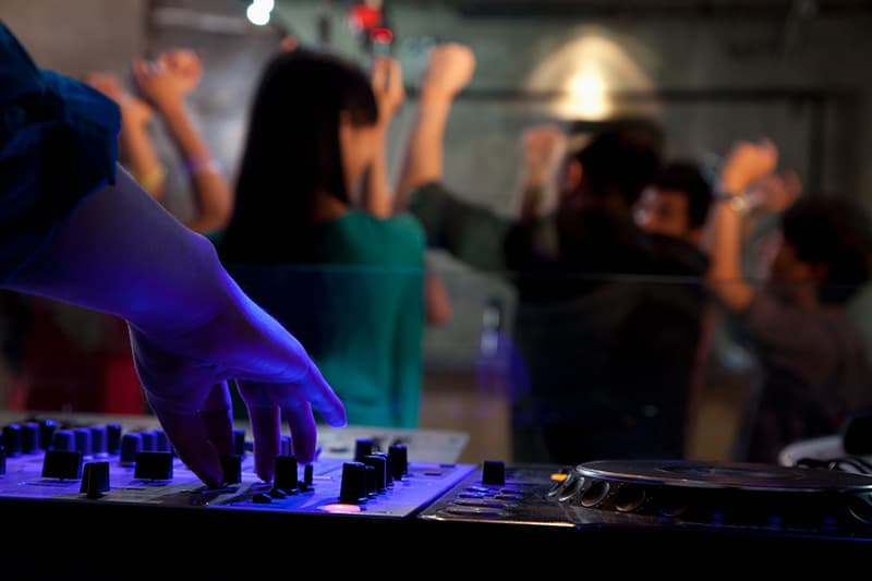 DJ performing at a small party.