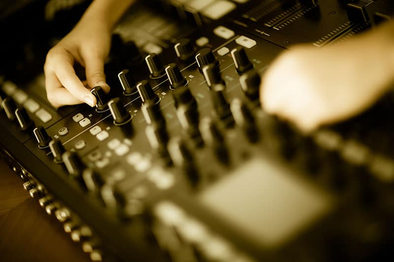 Photo of the central mixer section of a DJ controller