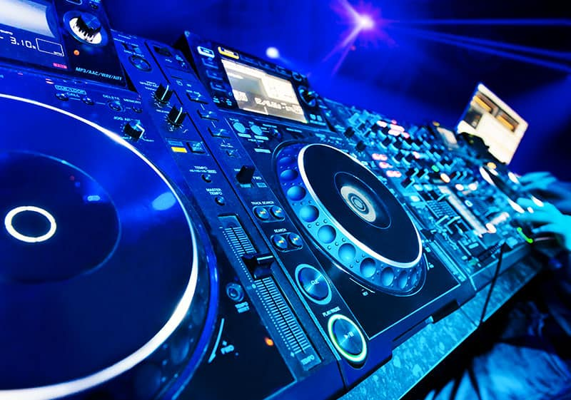 Photo of DJ equipment in a club environment