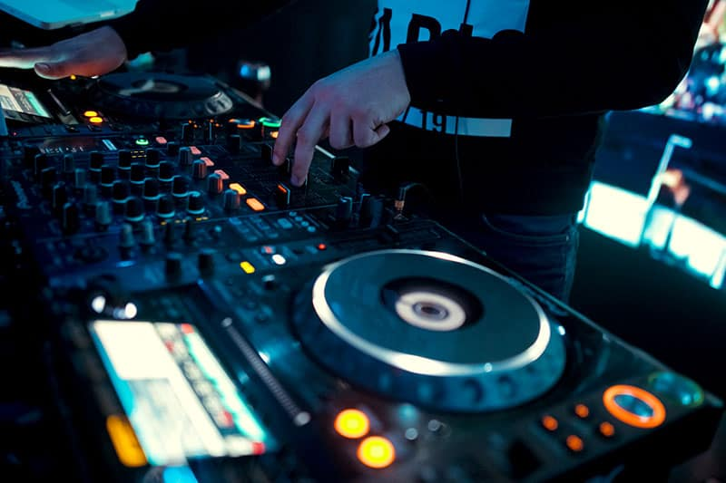 Pioneer DJ equipment in a club with a DJ playing music