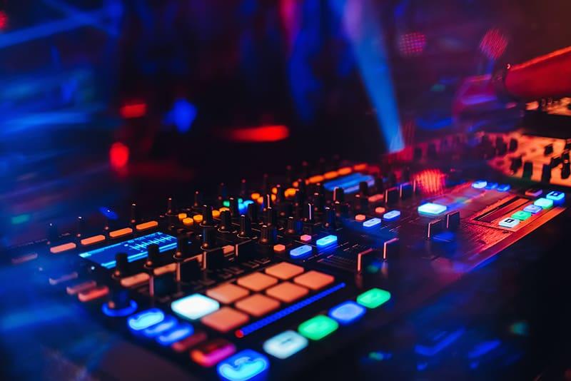 DJ using a Traktor controller in a club.