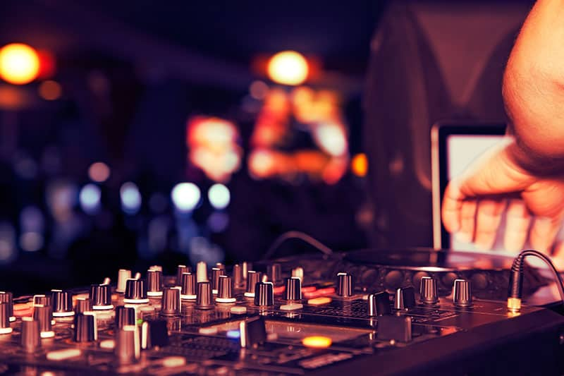 DJ using professional DJ equipment