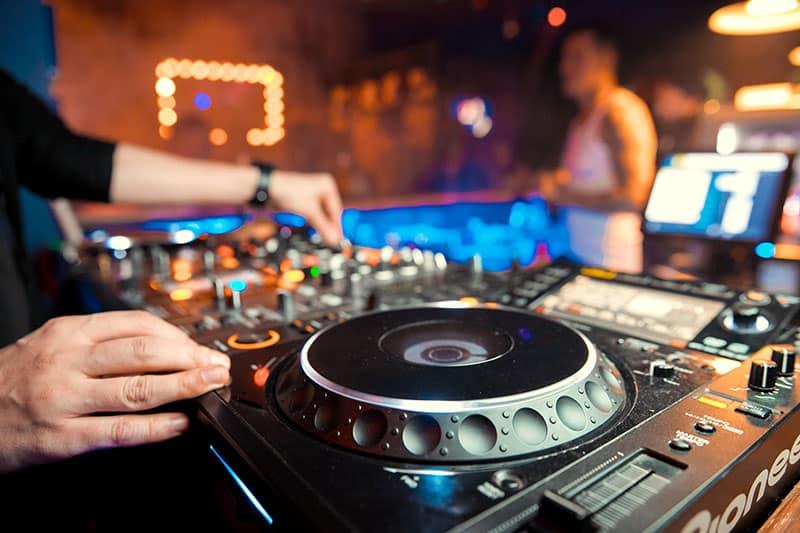 DJ using professional equipment in a night club