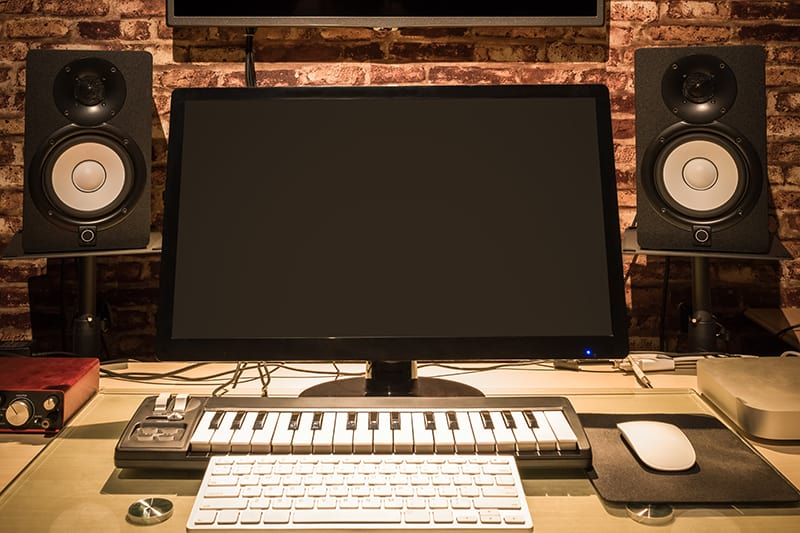 Photo of a small music production studio.
