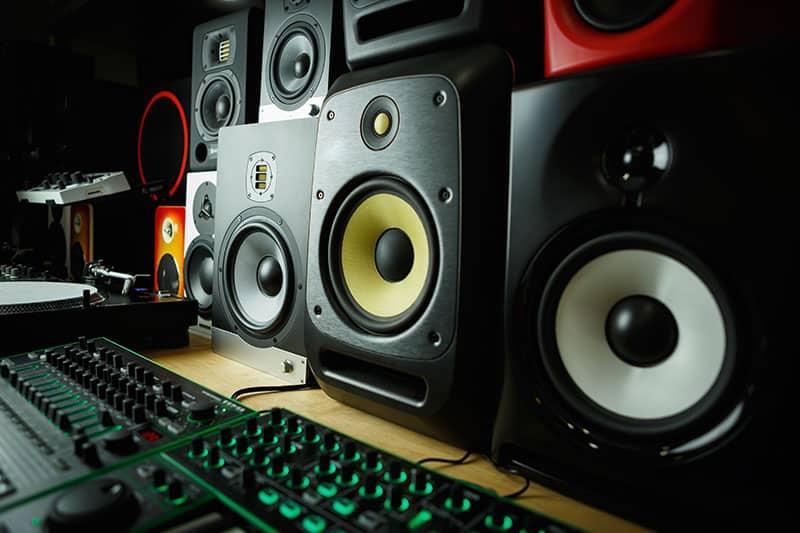 Various studio monitors in a studio.