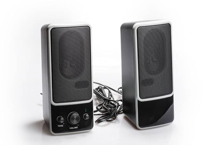 Plain computer speakers isolated on a white background