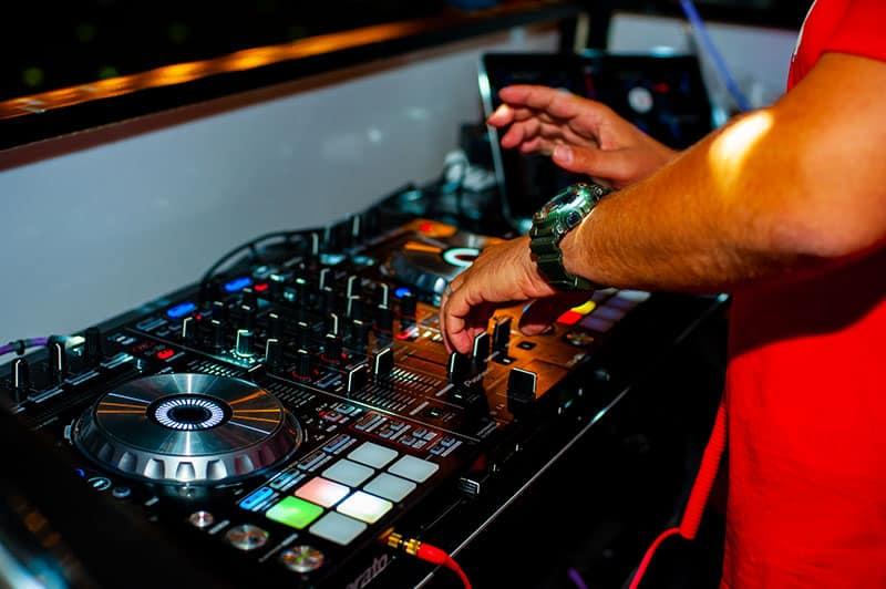 DJ using a DJ controller