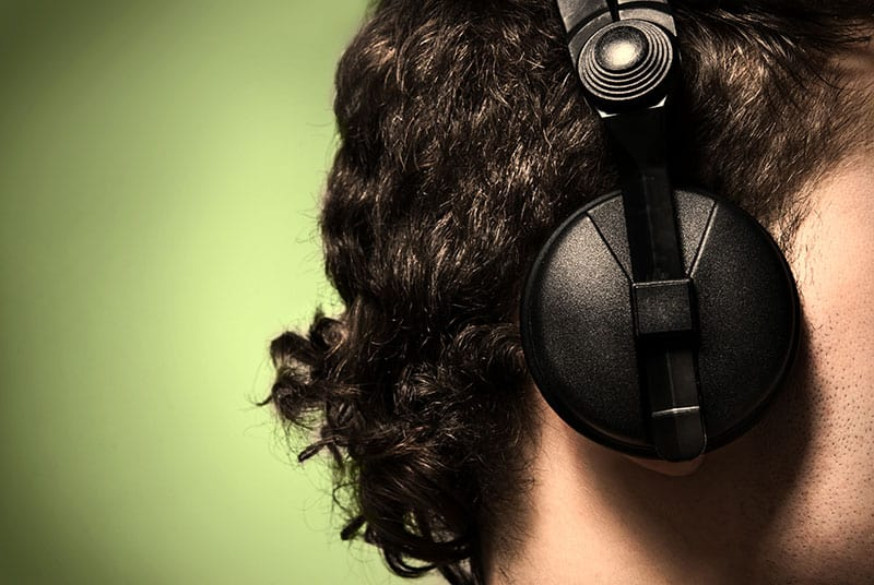 Headphones on a mans head