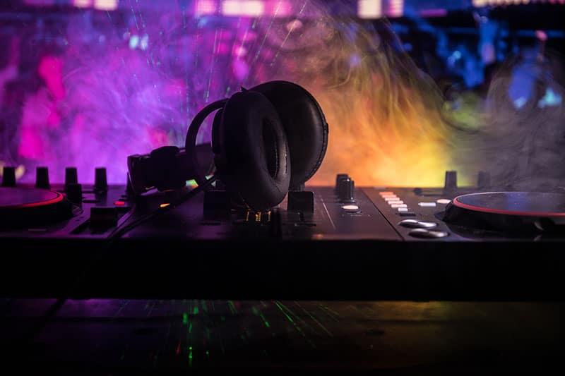 DJ Headphones sitting on top of DJ equipment