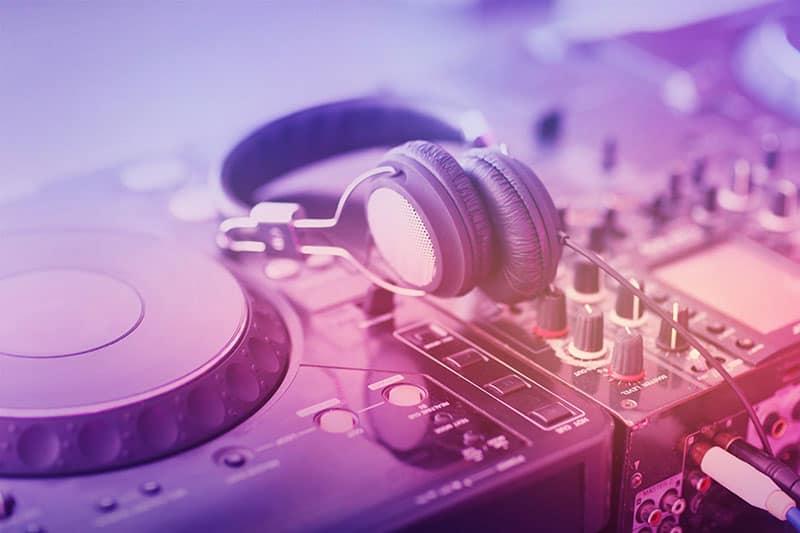 DJ headphones sitting on DJ equipment