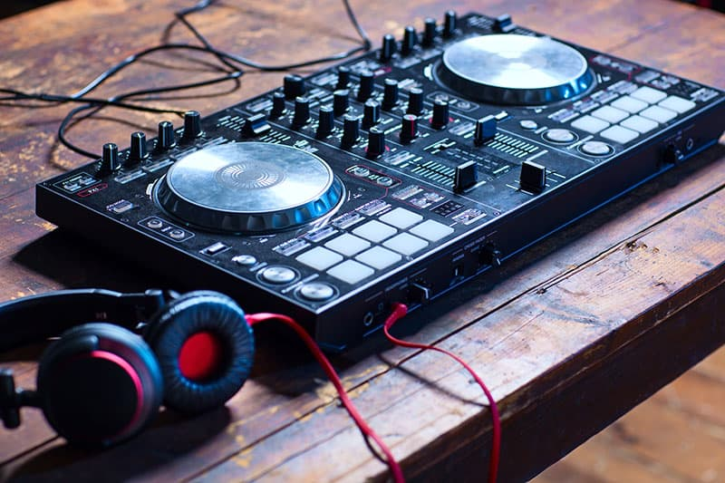 Dj controller on a table with headphones
