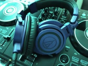 DJ headphones sitting on top of a DJ controller