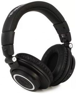 Three quarter view of a pair of Audio-Technica ATH-M50XBT headphones